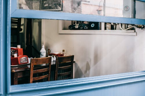 Opened window of cafe with old interior