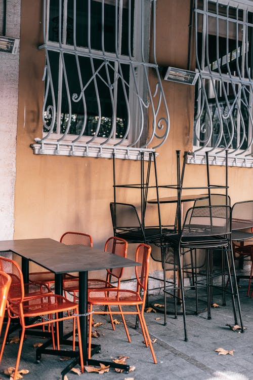 Street cafe with metal tables and chairs