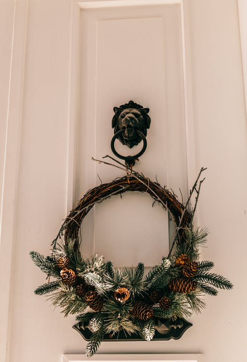 Decorative door wreath hanging on lion knocker