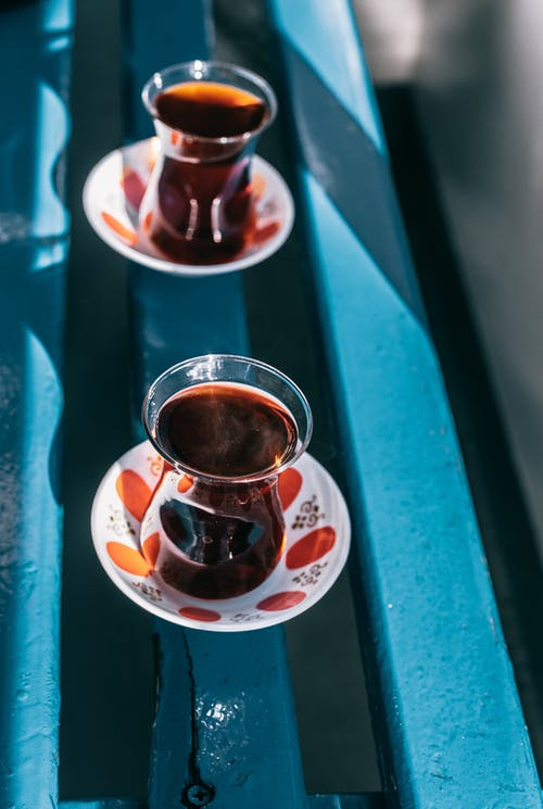 Glasses with aromatic tea on street