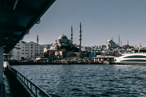 Embankment with sea and ancient mosque