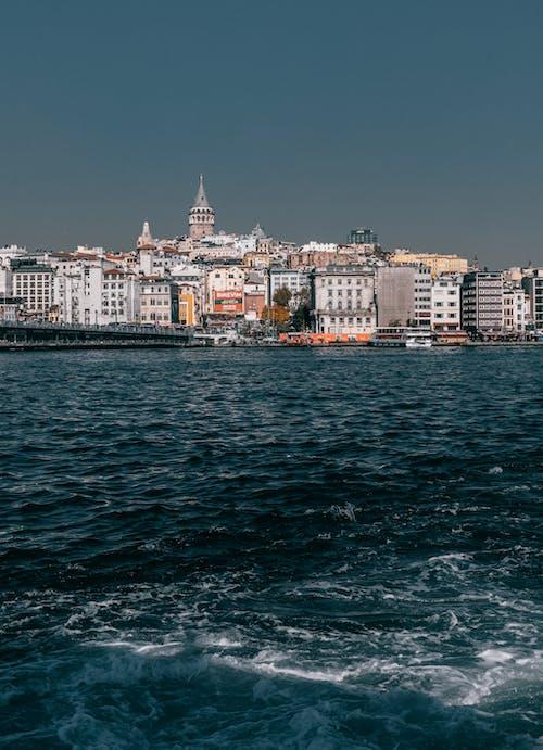 Rippling water against coastal city