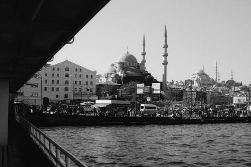 Black and white of embankment with calm sea and Hagia Sophia grand mosque on background located in Istanbul in Turkey