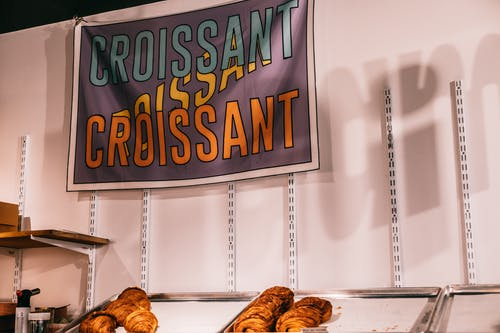 Colorful Croissant signboard on wall