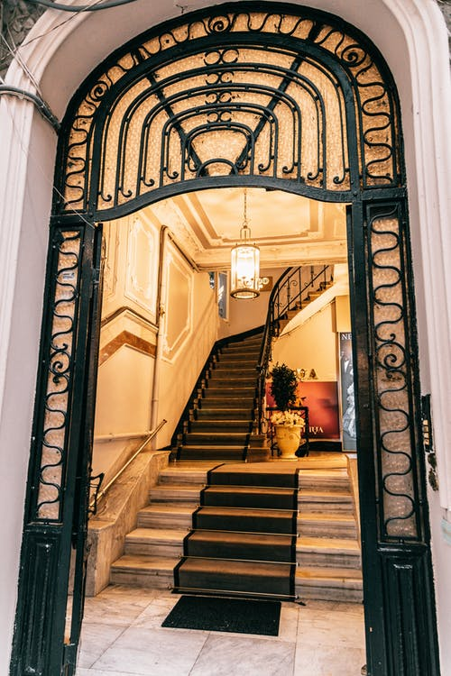 Grand mansion staircase near ornamental entrance