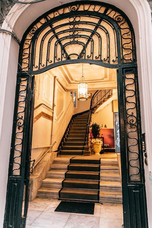 Grand mansion staircase near ornamental entrance