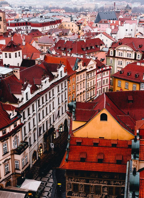 From above of old European city with classic residential houses with colorful roofs