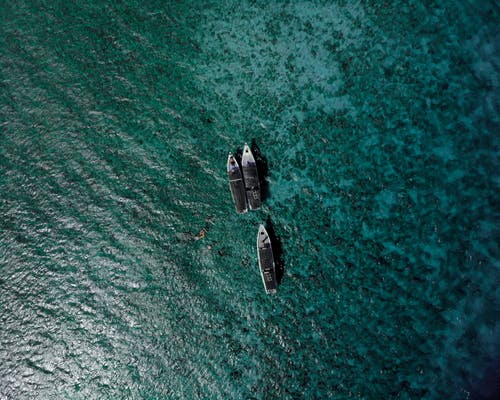 Ships floating over ocean surface