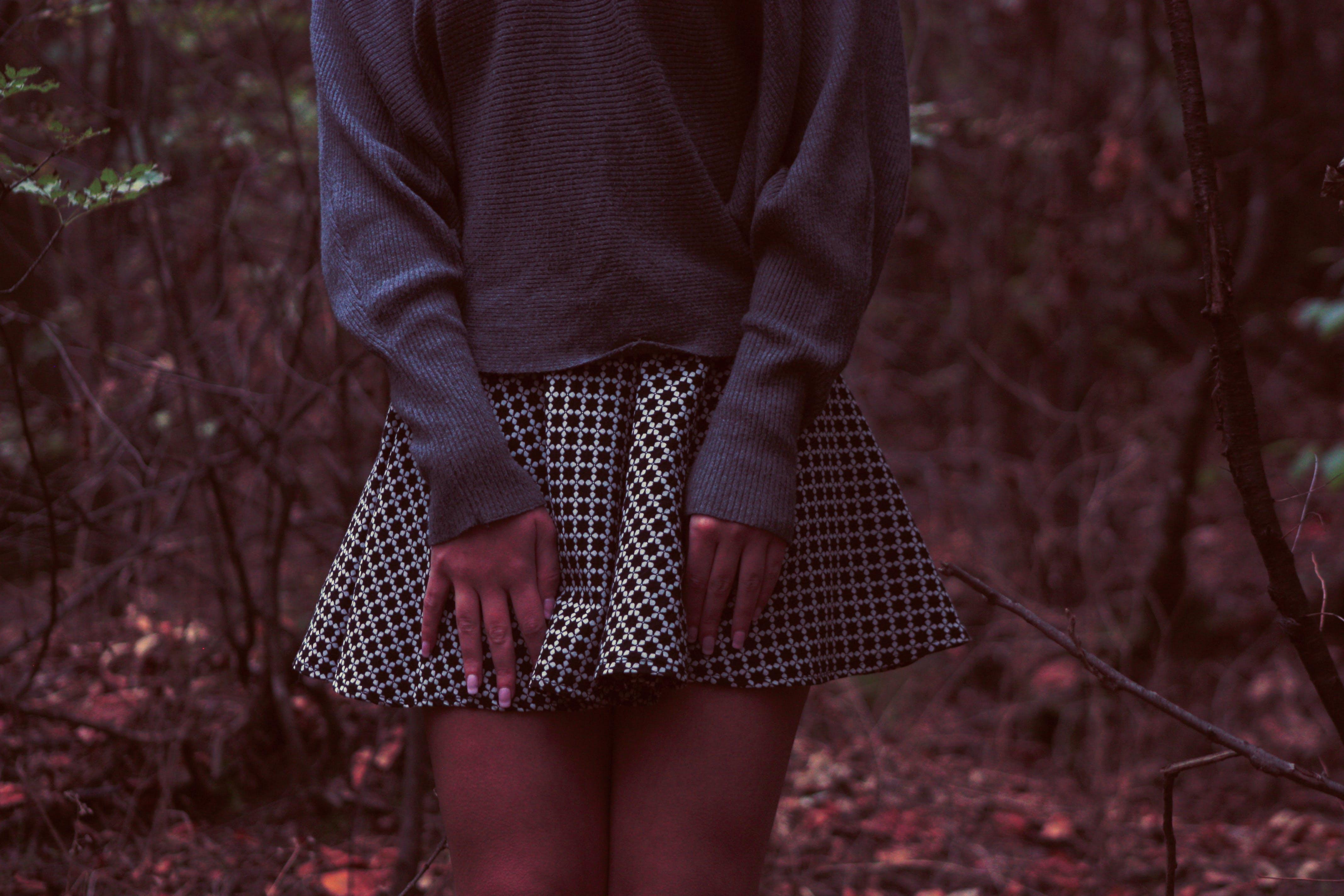 Woman Touching Her Skirt