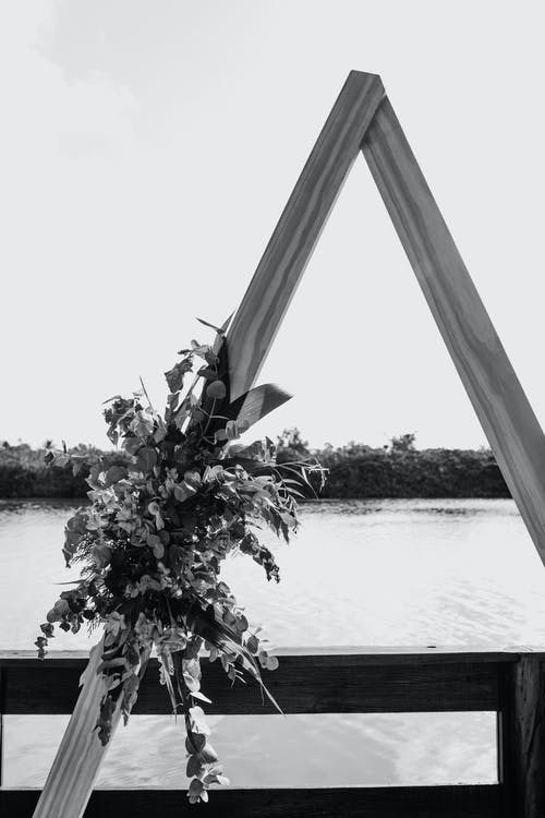 Bridal bouquet on wooden terrace above river