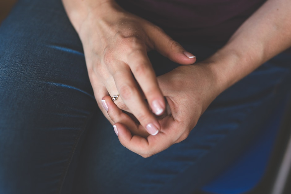 Woman tries on her diamond engagement ring