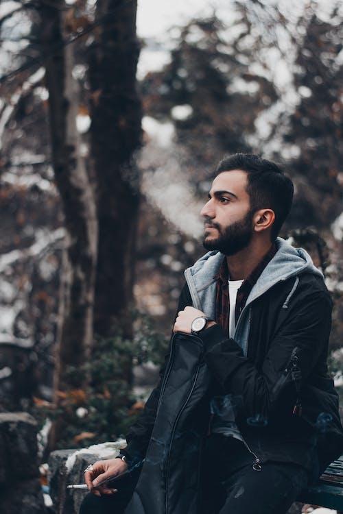 Man in Black Jacket Standing Near Trees