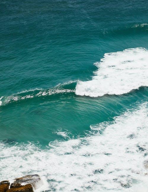 Foamy azure sea water surface