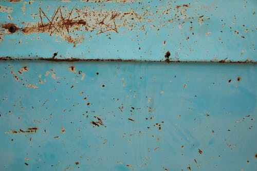 Shabby rusty metal surface with scratches