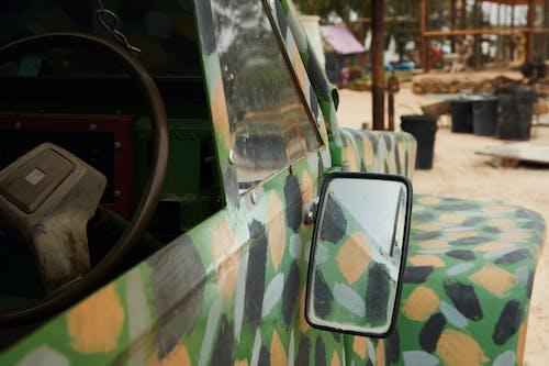 Old broken car painted in various colors