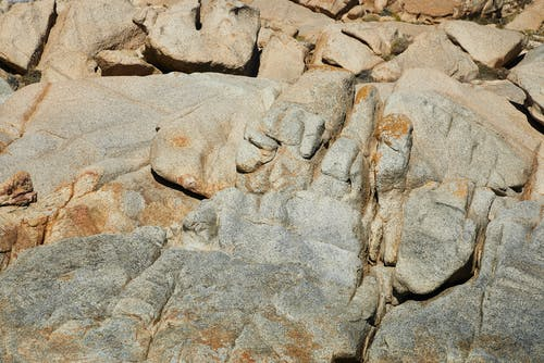 From above of rocky hard formation with uneven surface in nature in daytime