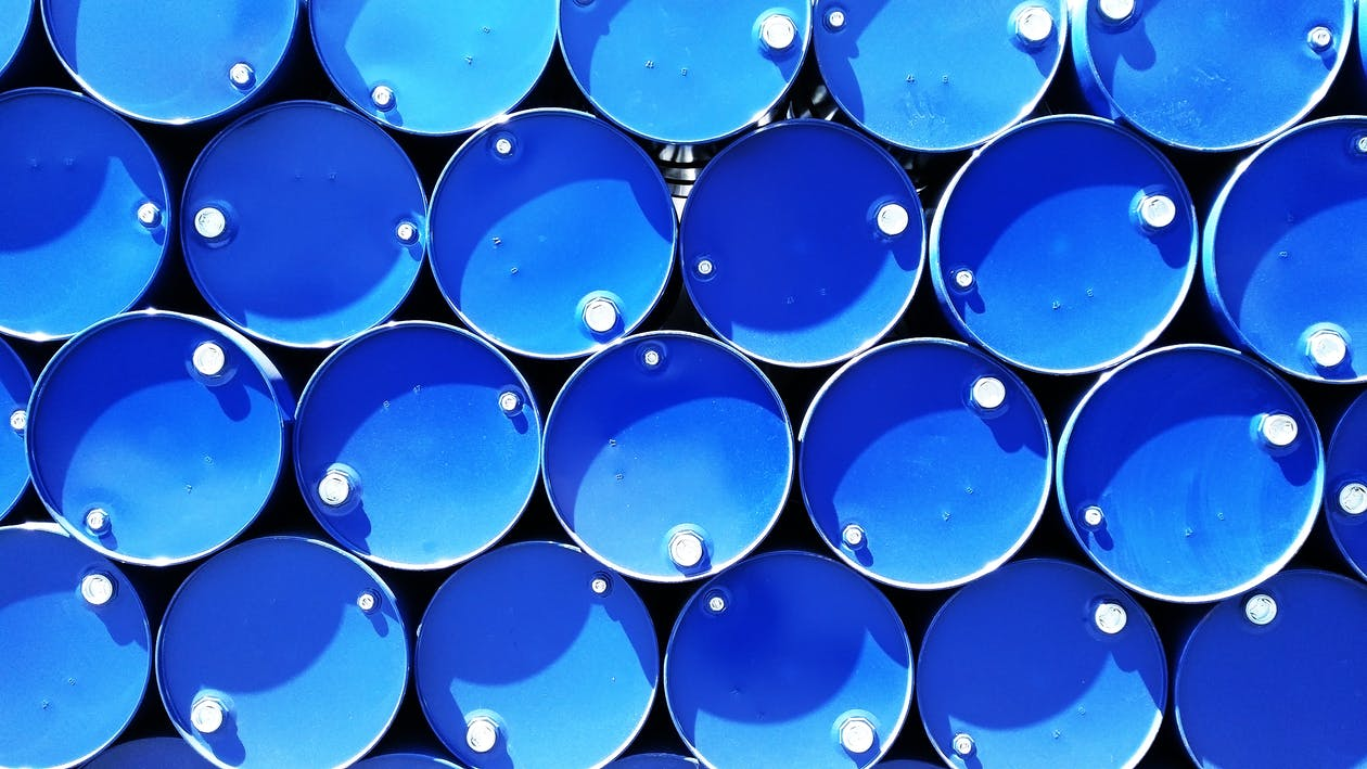 High Angle Photograph of Blue Metal Barrels