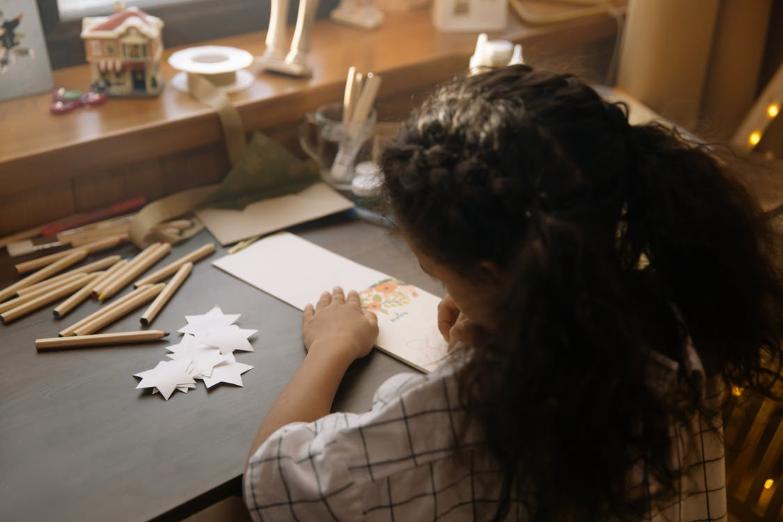 A Girl Writing a Christmas Letter