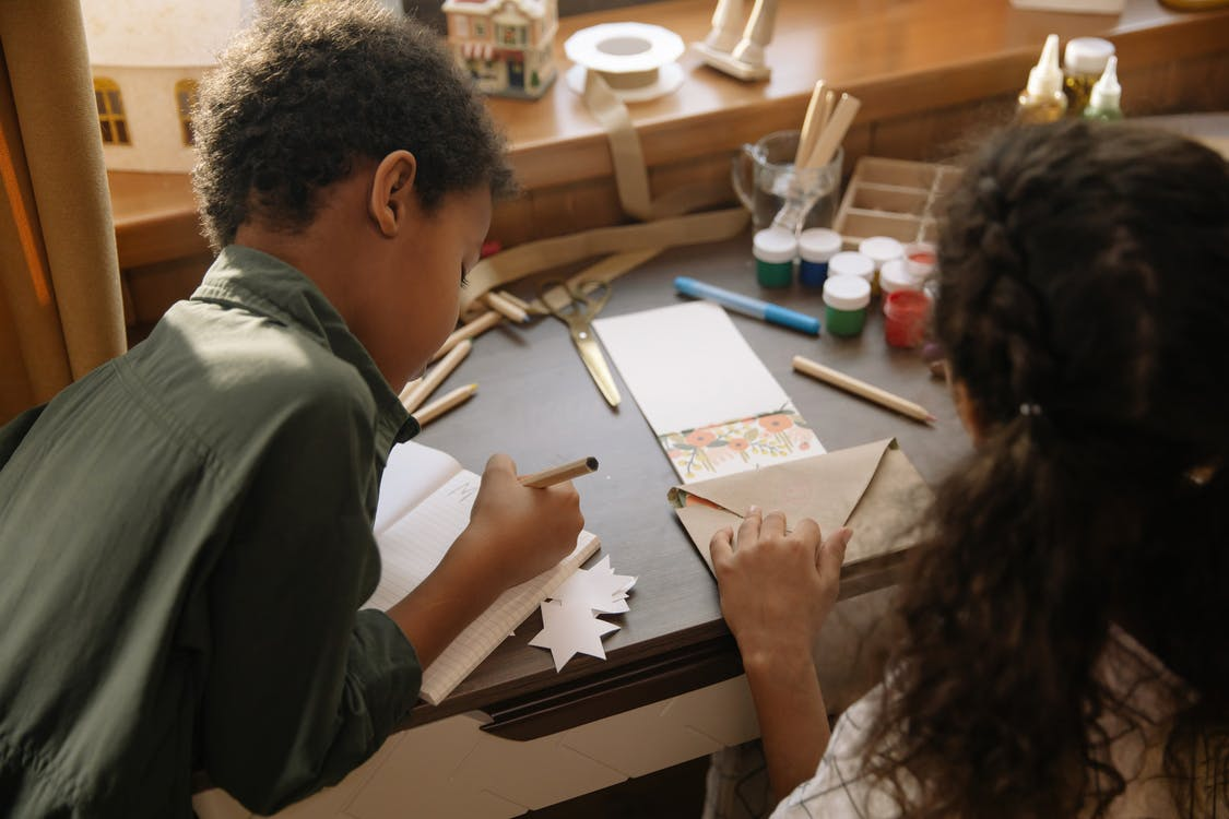 Two Kids Making and Writing a Christmas Letter