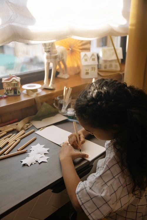 A Girl Making a Christmas Letter