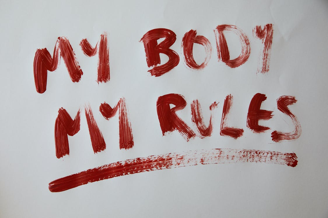 Inscription My body my rules against gray background