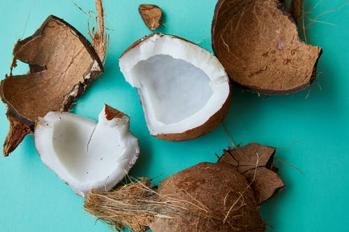 Pieces of cracked coconut with aromatic white pulp
