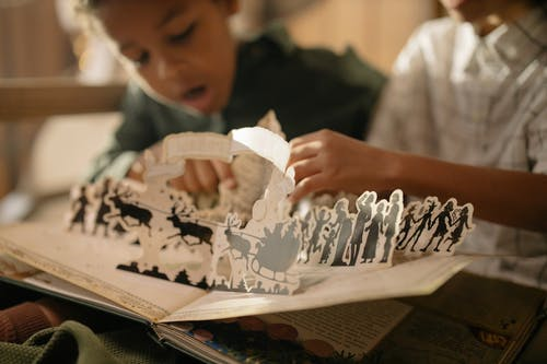 Two Kids Reading a Cutouts Fairy Tale Book