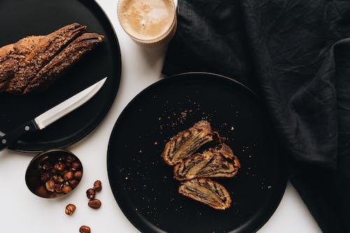 Brown Cookies on Black Plate Beside White Ceramic Mug