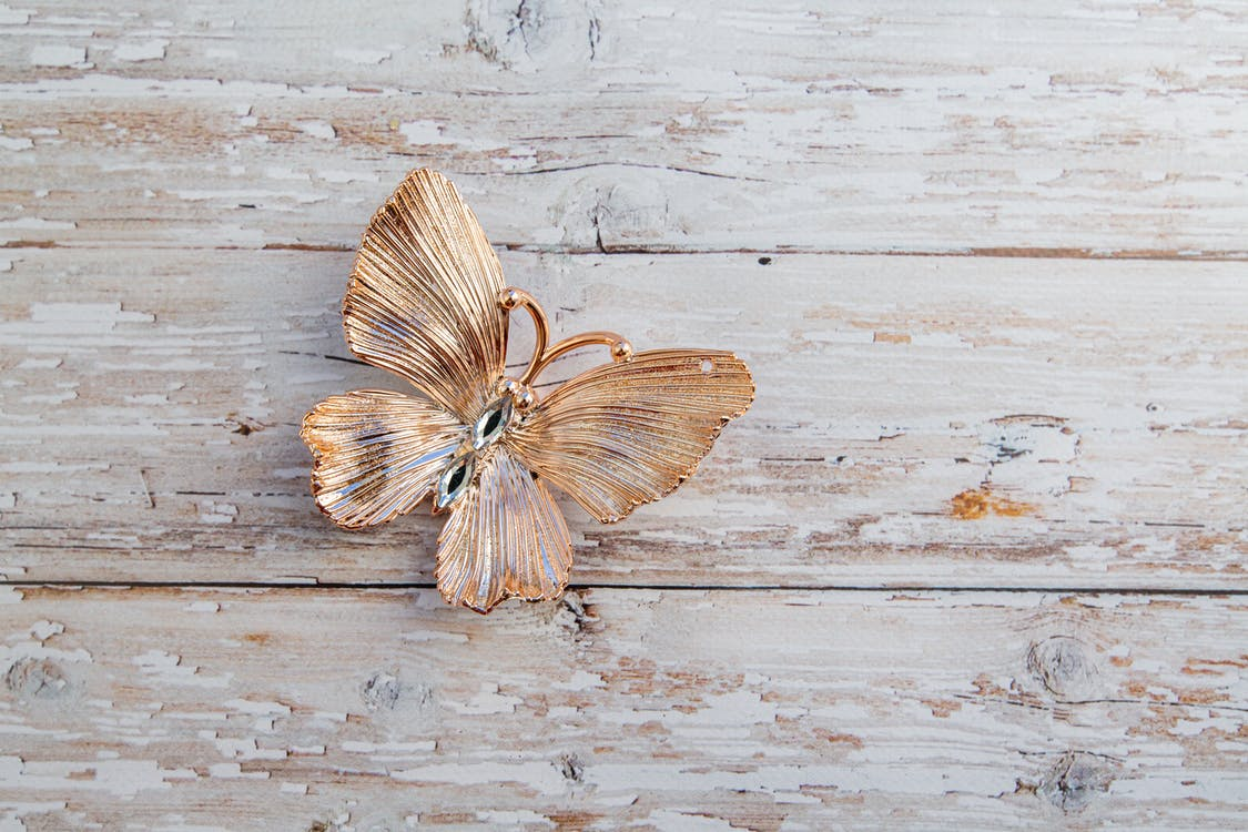 Gentle decorative butterfly placed on wooden surface