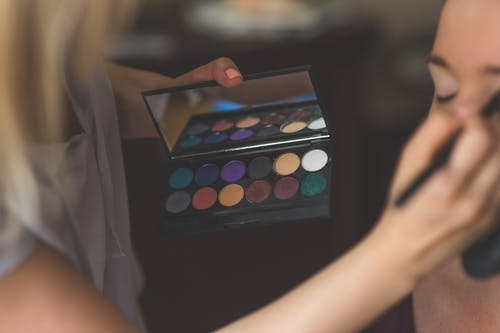 Make-up artist applying eyeshadows