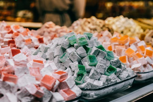 Assortment of sugar starch cubes sprinkled with powdered sugar