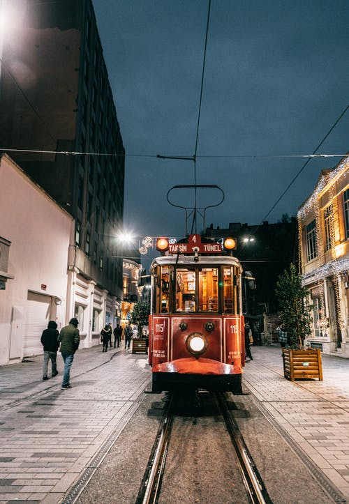 Old tramway riding on railroad in dark city