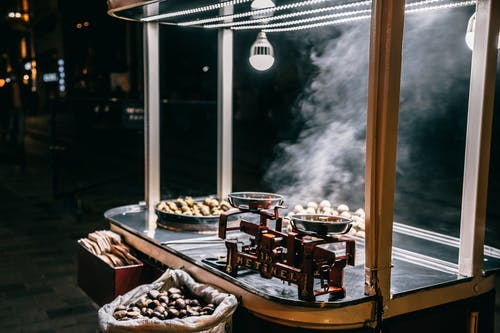 Roasted chestnuts selling in food cart on street