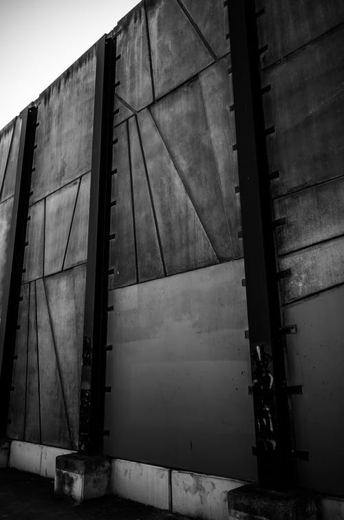 Black Steel Wall in Grayscale Photography