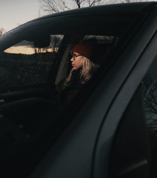 Woman in Black Jacket Sitting Inside Car