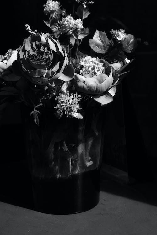 Vase with flowers on floor