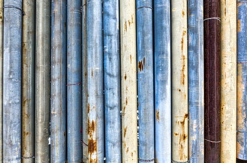 Wall with various thick shabby pipes