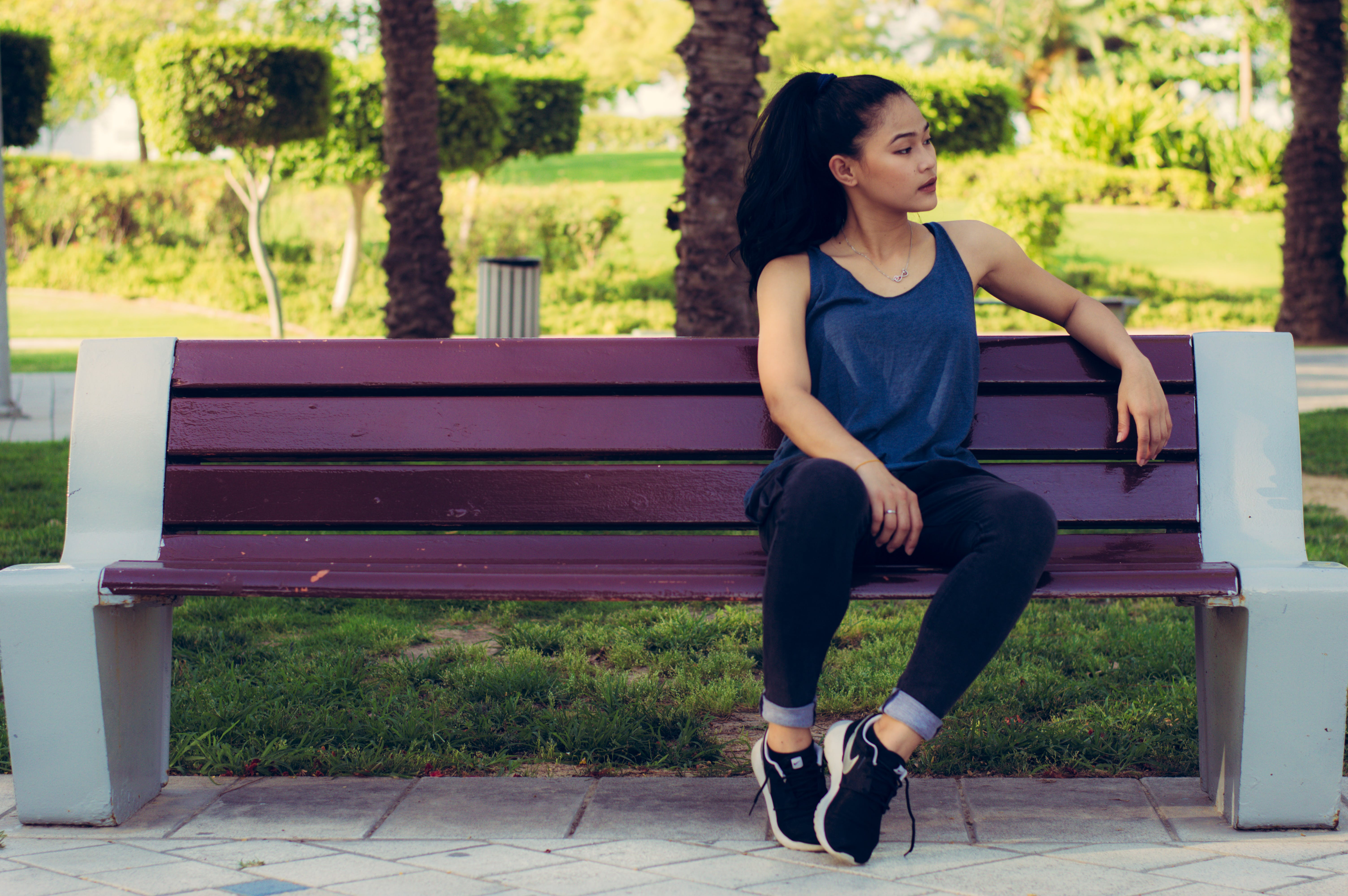Woman Sitting on Purple Bench