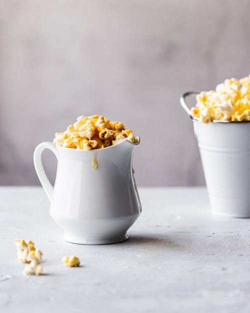 Yummy Popcorn with Caramel on White Ceramic Pitcher