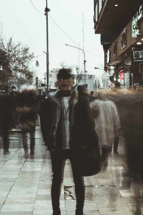 Man in Black Jacket Standing on Sidewalk