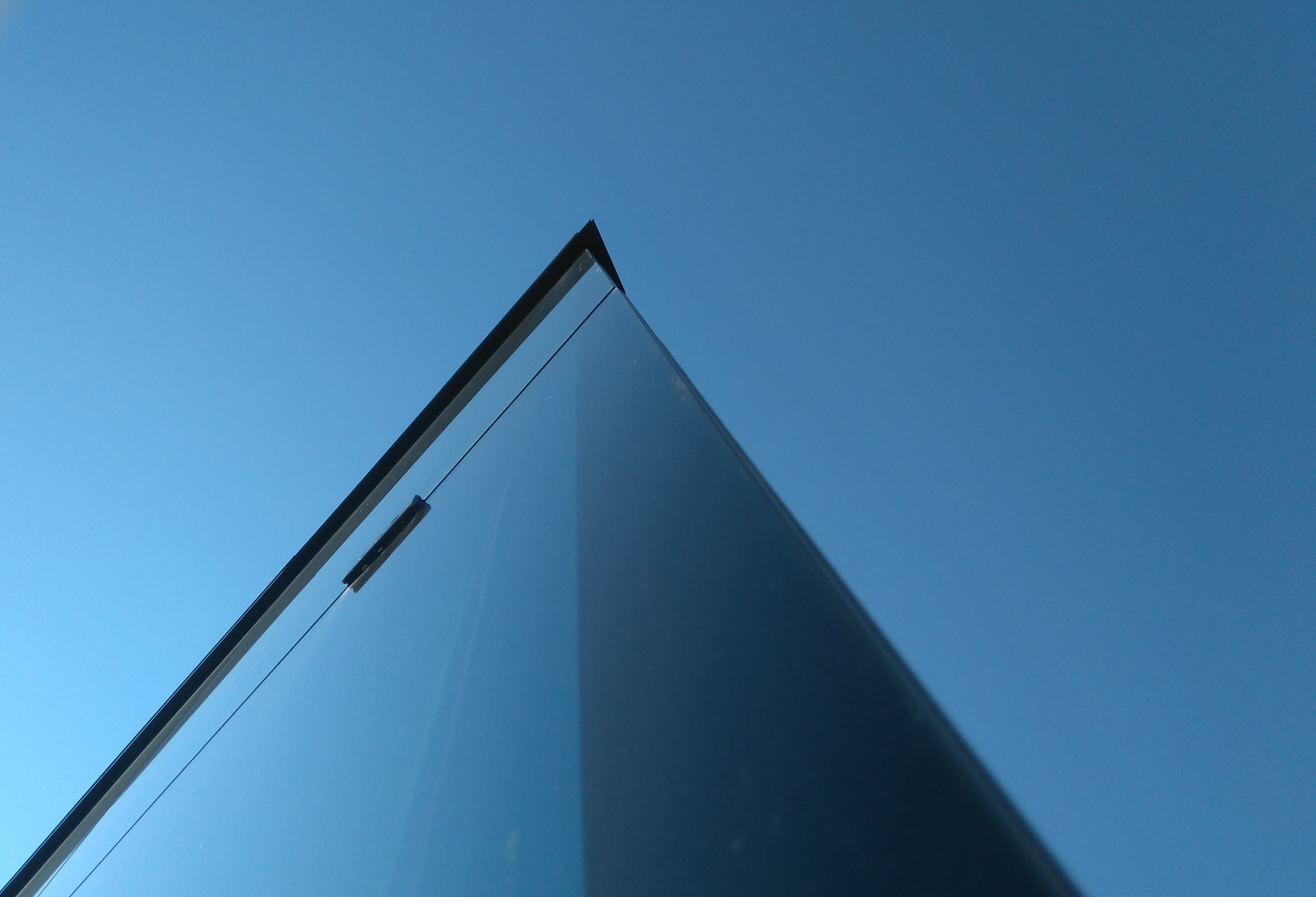 Low-angle Photography of Laminated Glass Building