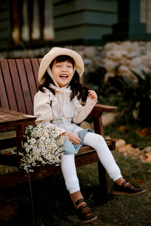 Happy Asian girl sitting on chair