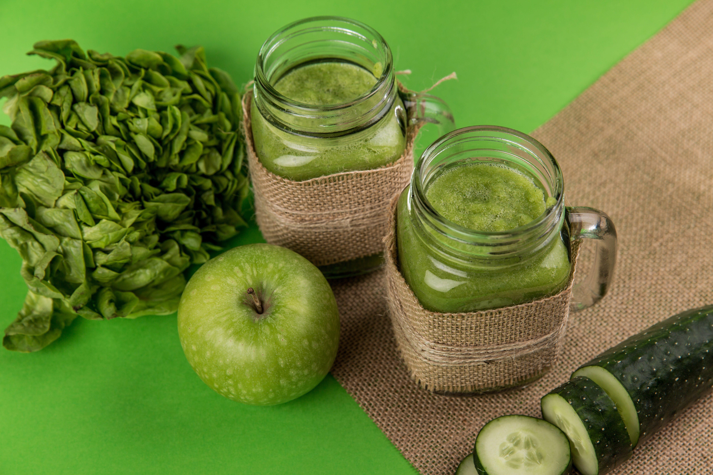 Green Apple Beside Two Jars