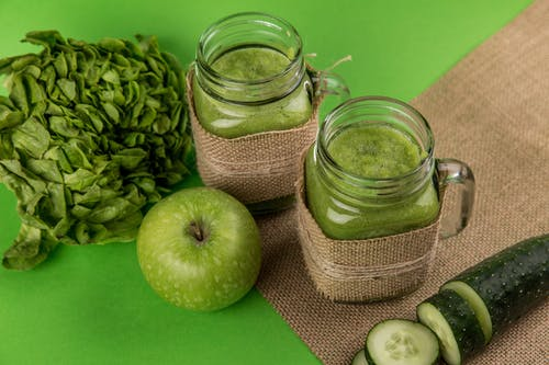 Green Apple Beside Two Jars