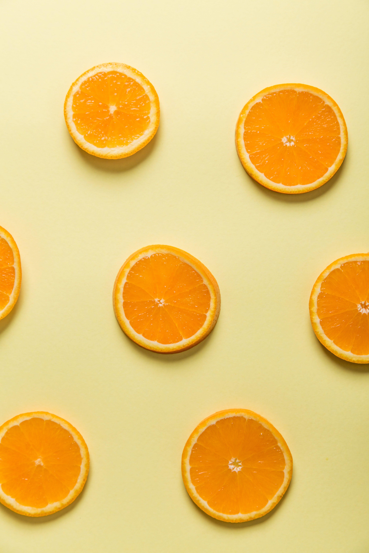 Бесплатное стоковое фото с апельсин, вид сверху, вкусный, нарезанный