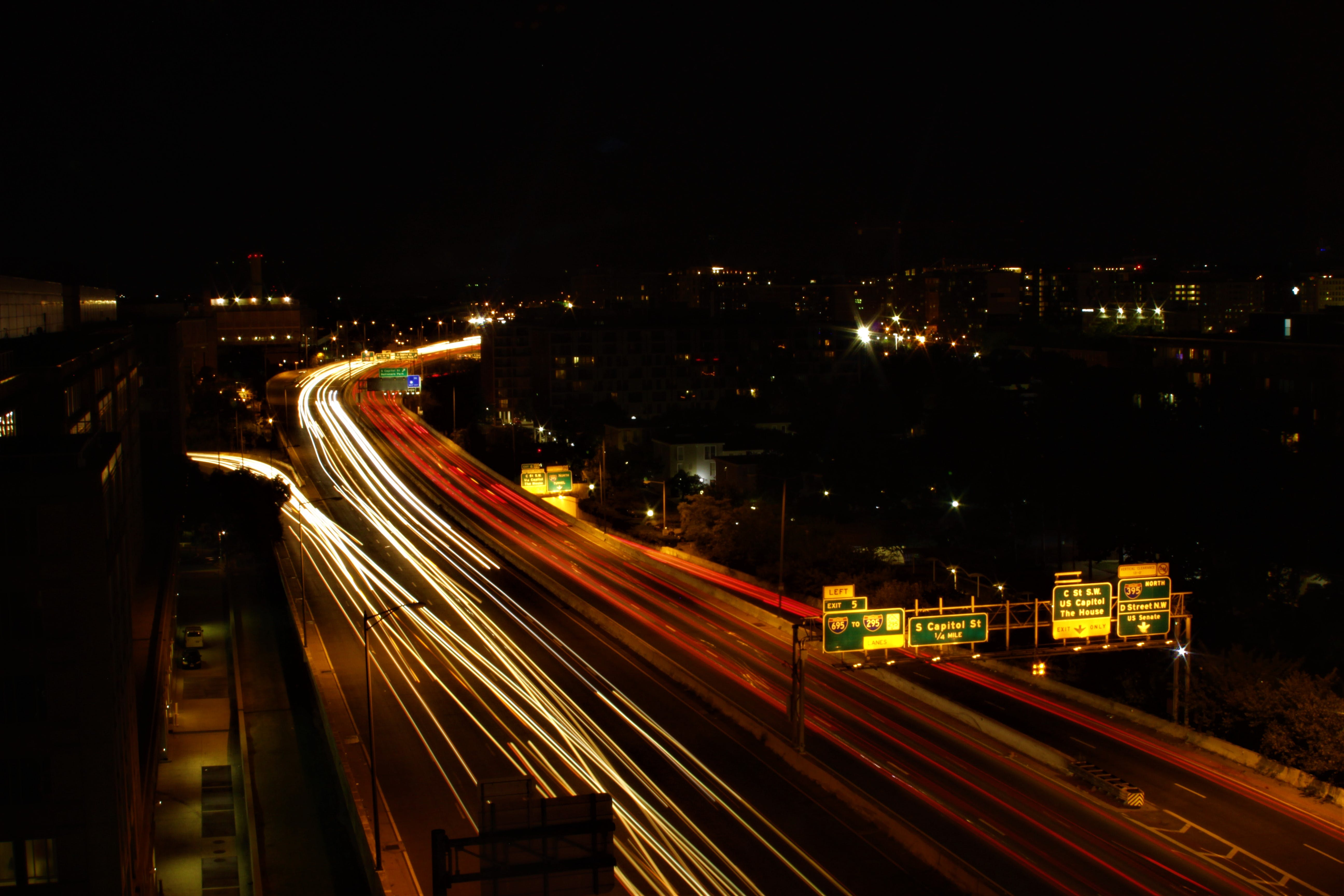 Panning Photography of Vehicles on Road at Night