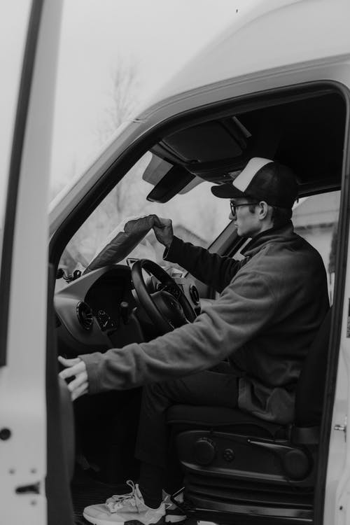 Man in Black Jacket Sitting Inside Car