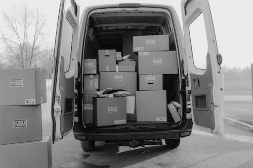 Brown Cardboard Boxes in Black Car