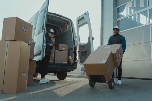 A Man and a Woman Working for a Delivery Company