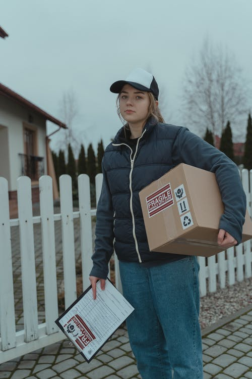 A Woman Making a Package Delivery